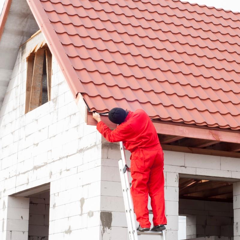 roofer doing final improvements
